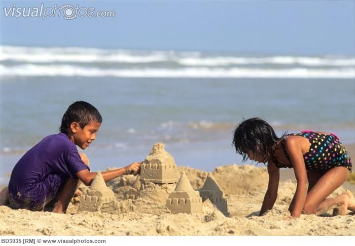 Children Building a Sand Castle