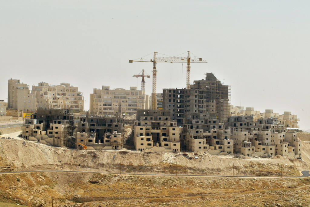 IN THE WEST BANK SETTLEMENT OF MAALEH ADUMIM NEAR JERUSALEM CONSTRUCTION CONTINUES ON A NEW NEIGHBOURHOOD THAT WILL HOUSE 15,000 PEOPLE BY 2008