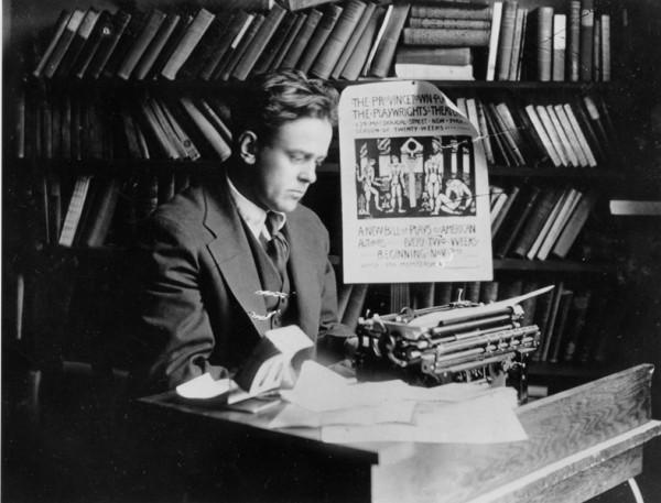 John Reed at desk