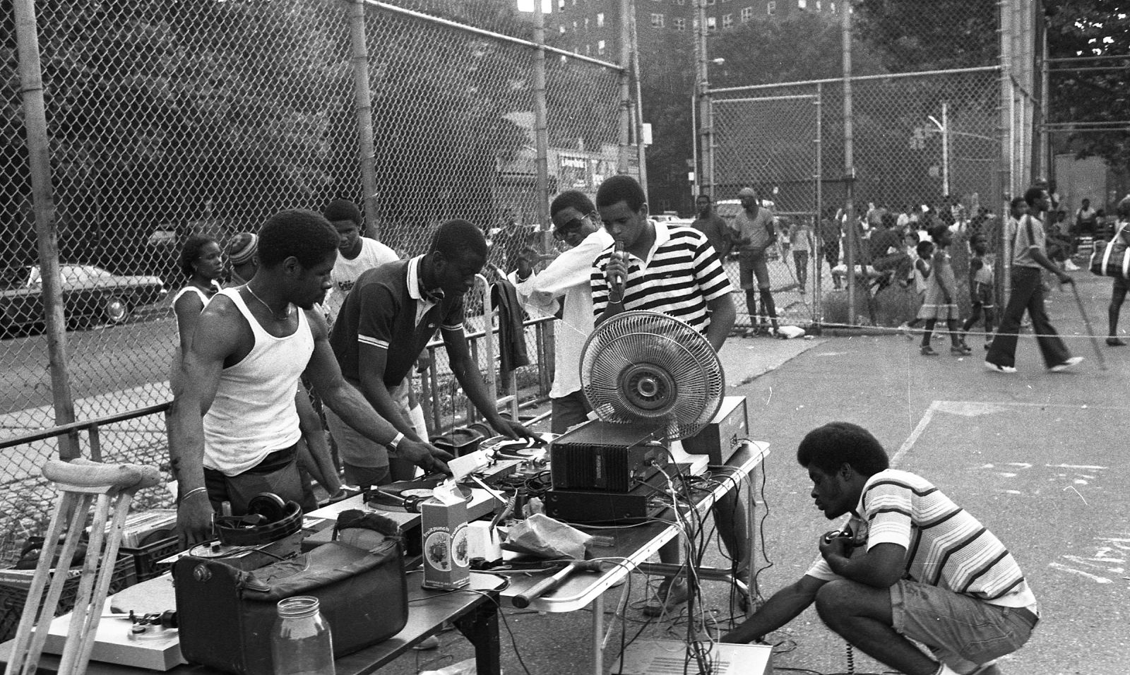 A classic rapper and DJ set at a Bronx a park, taken by legendary hip-hop photographer Henry Chalfant. (Photo Credit: http://henrychalfant.com)
