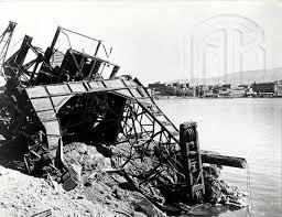 Καταστροφές των Γερμανών στο λιμάνι του Πειραιά λίγο πριν την αποχώρησή τους, Γενικά Αρχεία του Κράτους – Κεντρική Υπηρεσία – Βασίλης Τσακιράκης.