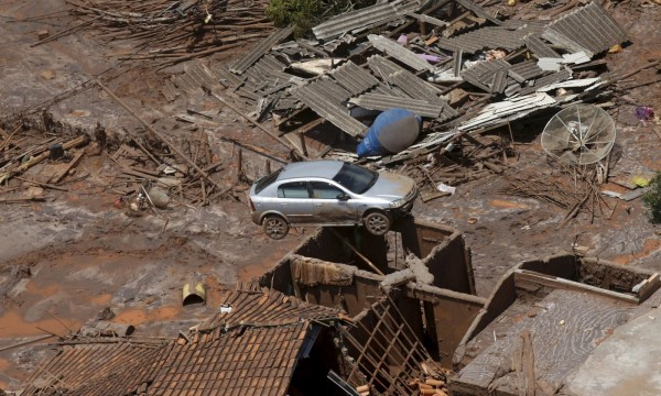 Debris is pictured in Bento Rodigues district which was covered with mud after a dam owned by Vale SA and BHP Billiton Ltd burst, in Mariana