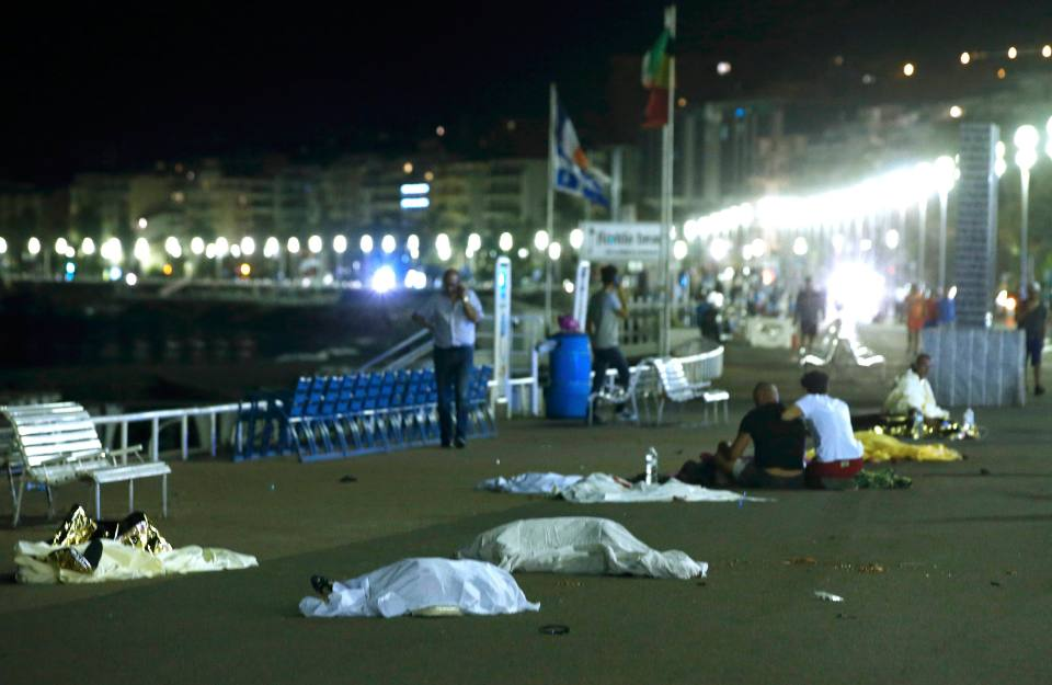 ATTENTION EDITORS - VISUAL COVERAGE OF SCENES OF INJURY OR DEATH - Bodies are seen on the ground July 15, 2016 after at least 30 people were killed in Nice, France, when a truck ran into a crowd celebrating the Bastille Day national holiday, July 14, 2016. REUTERS/Eric Gaillard TEMPLATE OUT.