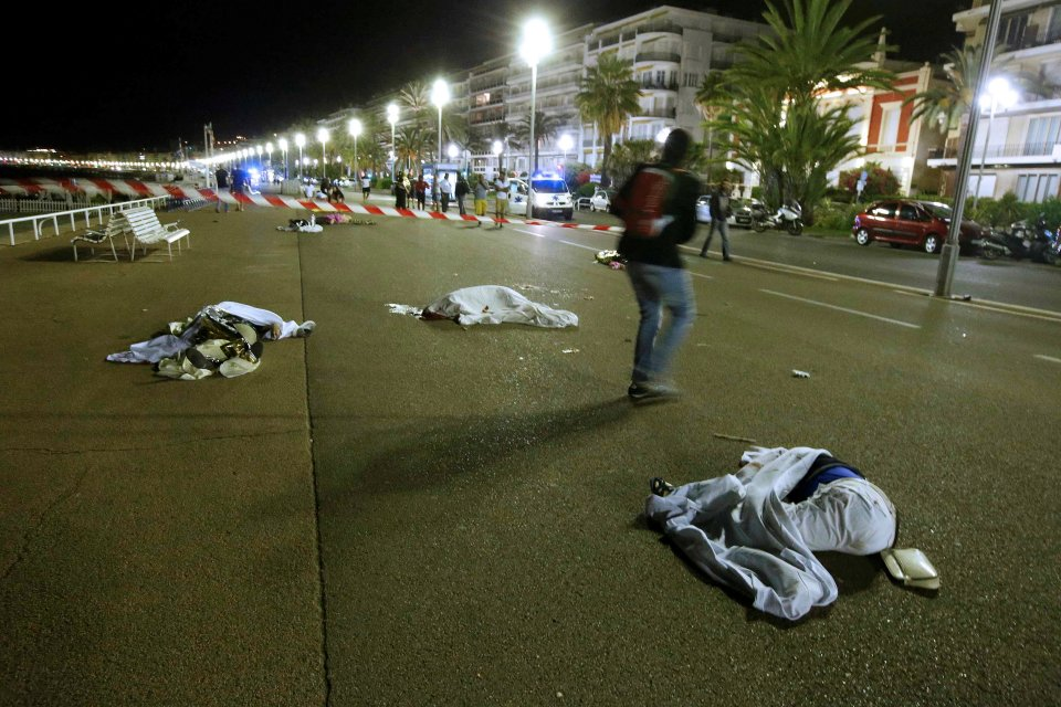 ATTENTION EDITORS - VISUAL COVERAGE OF SCENES OF INJURY OR DEATH - Bodies are seen on the ground July 15, 2016 after at least 30 people were killed in Nice, France, when a truck ran into a crowd celebrating the Bastille Day national holiday July 14. REUTERS/Eric Gaillard TPX IMAGES OF THE DAY