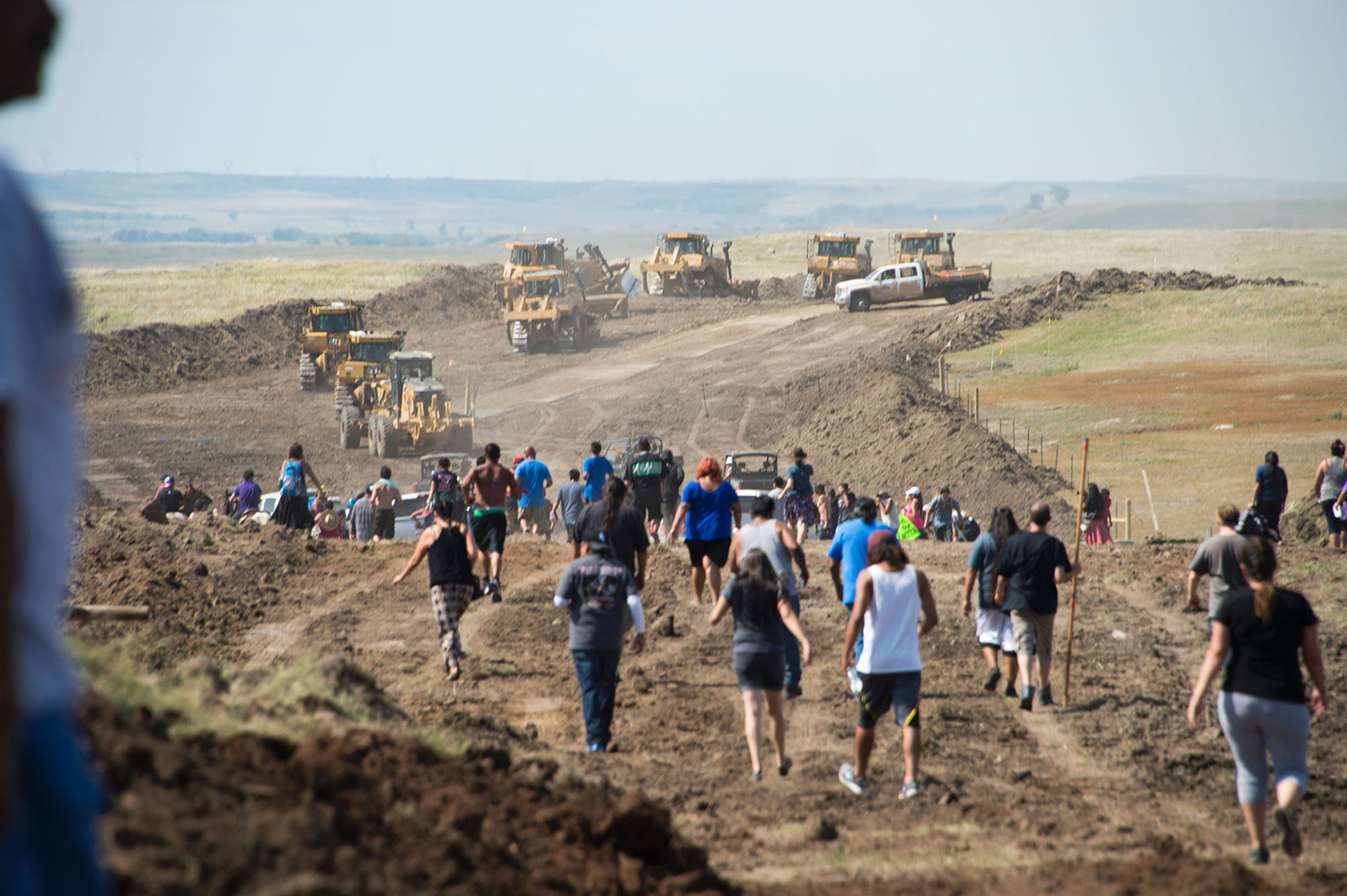 Native American protestors and their supporters are confronted by security during a demonstration against work being done for the Dakota Access Pipeline (DAPL) oil pipeline, near Cannon Ball, North Dakota, September 3, 2016. Hundreds of Native American protestors and their supporters, who fear the Dakota Access Pipeline will polluted their water, forced construction workers and security forces to retreat and work to stop. / AFP / Robyn BECK        (Photo credit should read ROBYN BECK/AFP/Getty Images)