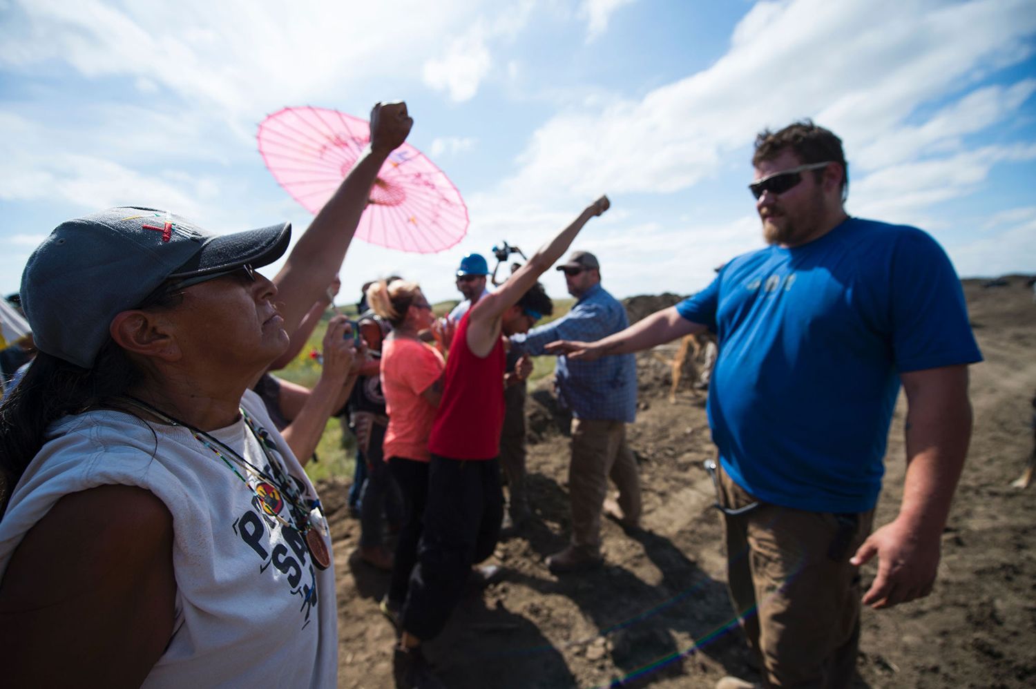 A Native American protestors holds up his arms as he and other protestors are threatened by private security guards and guard dogs, at a work site  for the Dakota Access Pipeline (DAPL) oil pipeline, near Cannon Ball, North Dakota, September 3, 2016.   Hundreds of Native American protestors and their supporters, who fear the Dakota Access Pipeline will polluted their water, forced construction workers and security forces to retreat and work to stop. / AFP / Robyn BECK        (Photo credit should read ROBYN BECK/AFP/Getty Images)