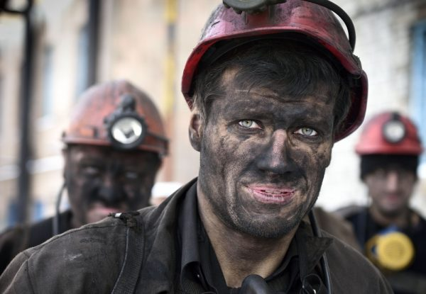 "TOPSHOTS Miners return from their shift at the Kalinina coal mine in the eastern Ukrainian city of Donetsk, controlled by pro-Russian rebels on December 1, 2014. Official statistics shows the country needs a million tonnes of anthracite coal per month to feed its power stations. By November 24, only 1.8 million tonnes were left in the reserves. Russia announced it was stopping coal supplies to Ukraine last week, claiming ""force majeure"" but offering no explanation. AFP PHOTO / ERIC FEFERBERG"