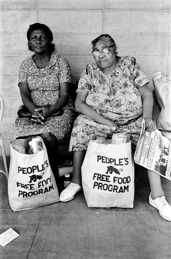 Two women with bags of food at the People's Free Food Program, one of the Panther's survival programs. 1972