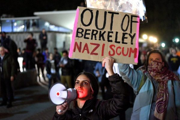epa05765839 Shadi Banoo (C) protests against Breitbart News editor Milo Yiannopoulos in Berkeley, California, USA, 01 February 2017. Hundreds of protesters rallied against Yiannopoulos, forcing the cancellation of his speech at UC Berkeley, eventually vandalizing dozens of businesses and smashing dozens of storefront windows. University police locked down all buildings after the protests turned violent.  EPA/NOAH BERGER