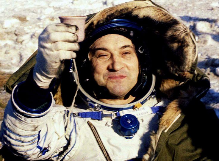 PUB 1 3-23-95 A a24 color as b/w [ARKALYK,KAZAKHSTAN,22MAR95 - Russian cosmonaut Valeri Polyakov toasts with a cup of hot tea as he sits in an arm chair after being taken out of the TM-20 landing unit which landed at 0400 GMT in the northeast of Arkalyk, in Kazakhstan March 22. Polyakov, 52, broke the edurance record of one year in space when he spent his 366th day in orbit on January 9. as/str REUTER :END CAPTION****** Caption By ASiREUTERS MOS07 MOS07 COSMONAUT VALERI POLYAKOV TOASTS STR 0 MOS07 COSMONAUT VALERI POLYAKOV TOASTS $ ]
