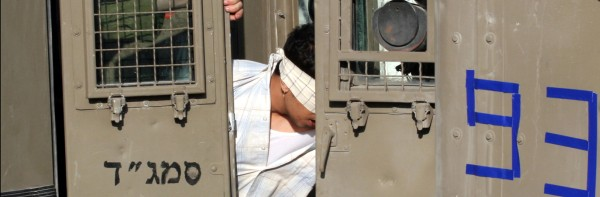 TORTURE-hooded-man-in-jeep_600x197