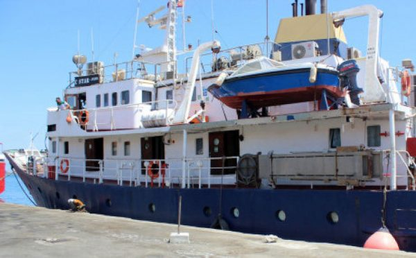 """A picture taken on July 27, 2017 shows the C-Star vessel, hired by far-right activists from a group which calls itself """"Generation Identity"""" to prevent would-be migrants from reaching Europem, anchored in the Mediterranean port of Famagusta in the self-proclaimed Turkish Republic of Northern Cyprus (TRNC).  Turkish Cypriot authorities have released the captain and crew of the ship, local media reported and the C-Star was expected to set off across the Mediterranean to Tunisia, said Kibris Postasi.   The """"Defend Europe"""" scheme was announced by anti-immigration campaigners from France, Italy and Germany after they crowd-funded the 76,000 euros ($87,000) needed to hire the vessel. / AFP PHOTO / STRINGERSTRINGER/AFP/Getty Images"""