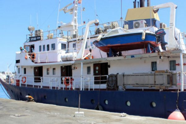 "A picture taken on July 27, 2017 shows the C-Star vessel, hired by far-right activists from a group which calls itself ""Generation Identity"" to prevent would-be migrants from reaching Europem, anchored in the Mediterranean port of Famagusta in the self-proclaimed Turkish Republic of Northern Cyprus (TRNC).  Turkish Cypriot authorities have released the captain and crew of the ship, local media reported and the C-Star was expected to set off across the Mediterranean to Tunisia, said Kibris Postasi.   The ""Defend Europe"" scheme was announced by anti-immigration campaigners from France, Italy and Germany after they crowd-funded the 76,000 euros ($87,000) needed to hire the vessel. / AFP PHOTO / STRINGERSTRINGER/AFP/Getty Images"