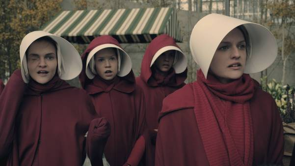 "The Handmaid's Tale -- ""Faithful"" -- Episode 105 -- Serena Joy makes Offred a surprising proposition. Offred remembers the unconventional beginnings of her relationship with her husband. Janine (Madeline Brewer), left and Offred (Elisabeth Moss), right, shown. (Photo by: George Kraychyk/Hulu)"