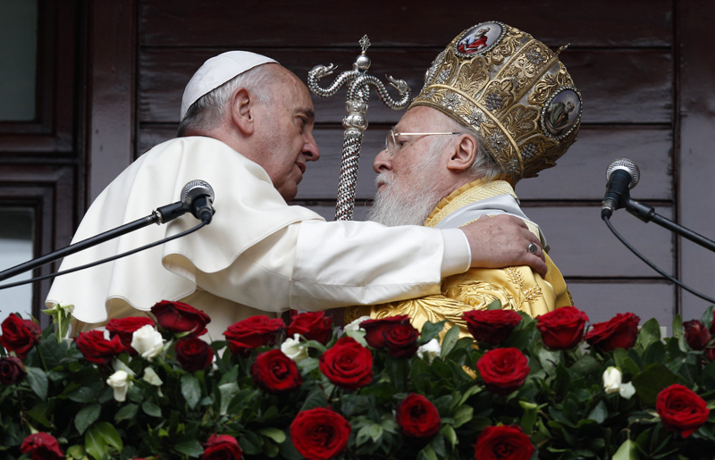 (RNS1-dec1) Pope Francis and Ecumenical Patriarch Bartholomew of Constantinople embrace after delivering a blessing in Istanbul on Nov. 30, 2014. Phoot by Paul Haring, courtesy of Catholic News Service
